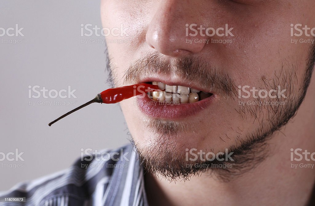 man with red chili royalty-free stock photo