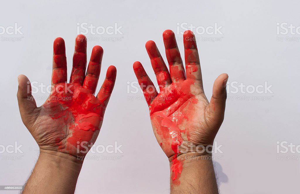 man with red handed stock photo