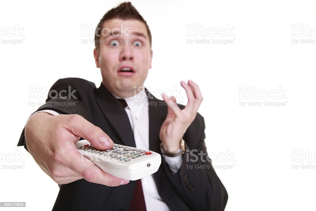 man with remote control changing channel stock photo