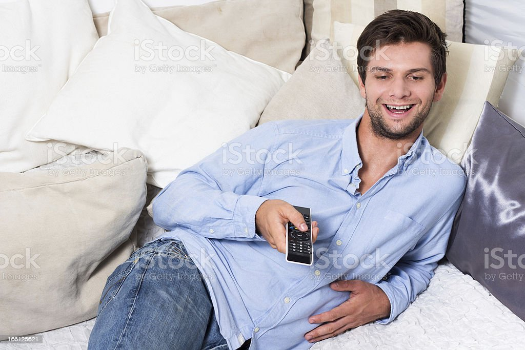 Man with remote control royalty-free stock photo