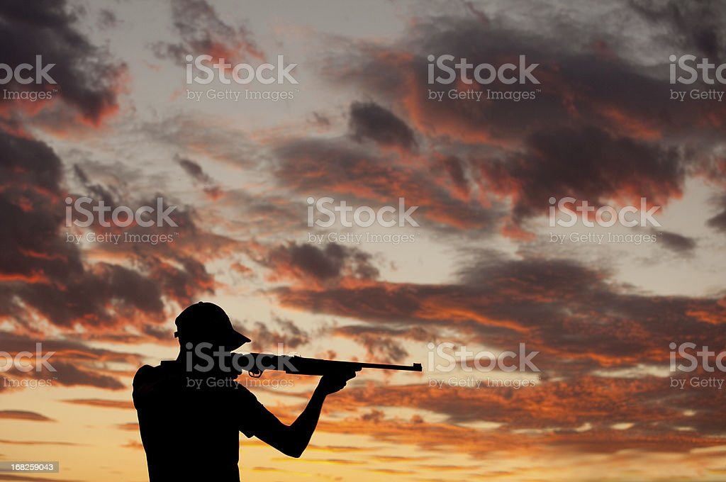 Man With Rifle stock photo