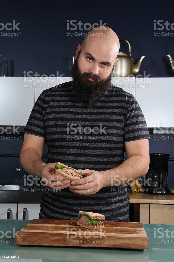 Man with Roast Beef Sandwich stock photo