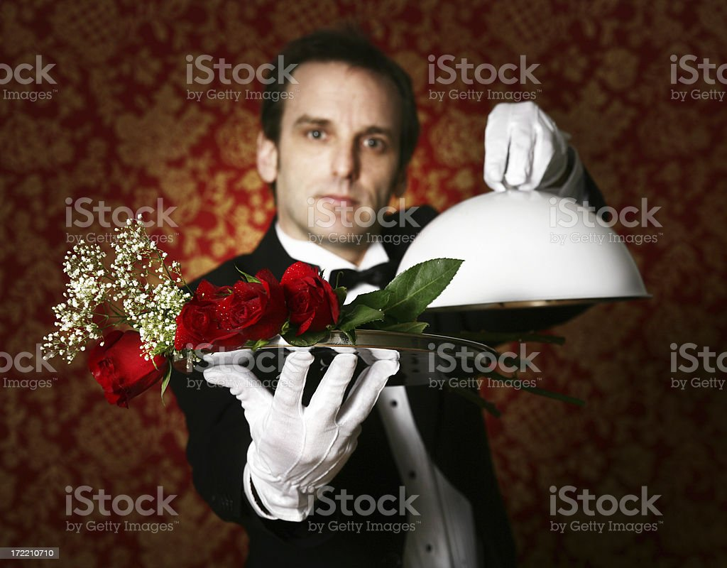 Man with roses in a plate royalty-free stock photo