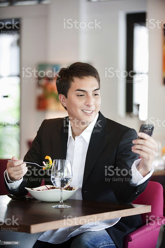 Man with Salad and Phone royalty-free stock photo