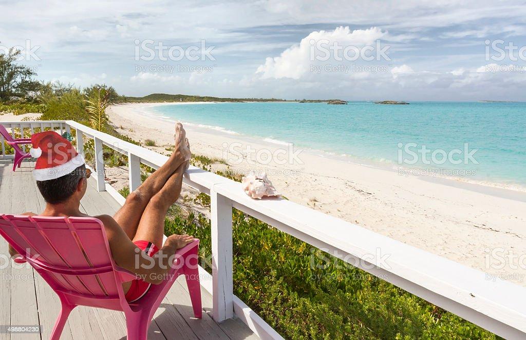 Man with Santa hat in relax - Bahamas stock photo