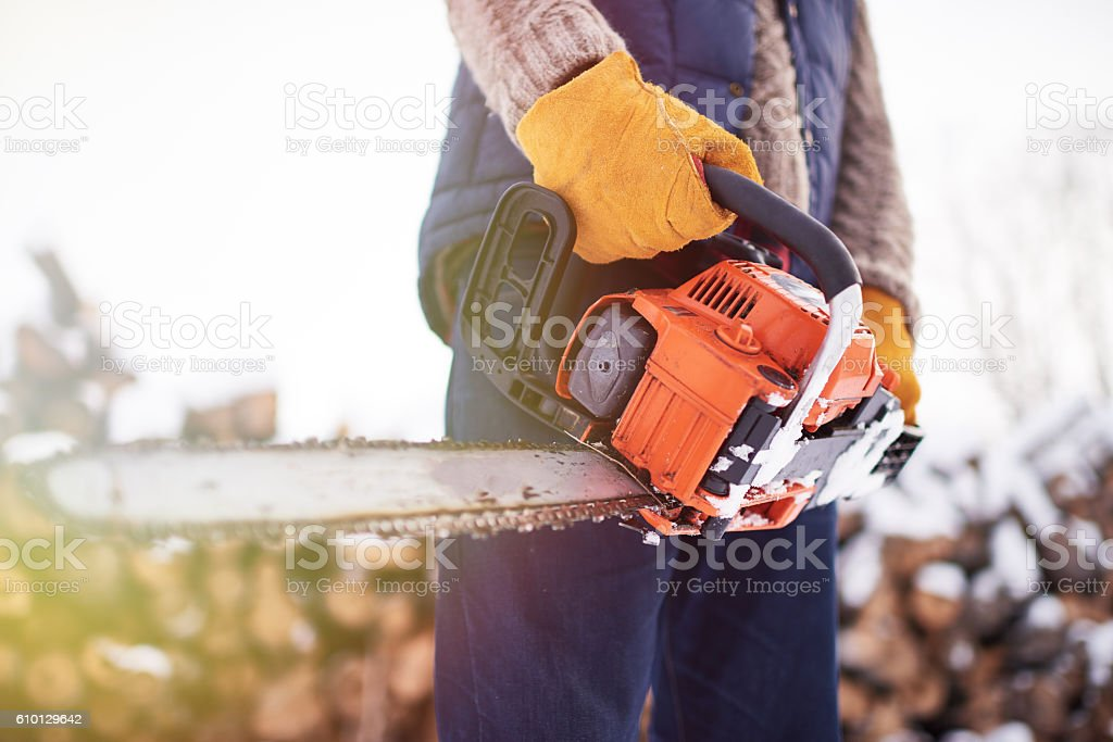 Man with saw stock photo