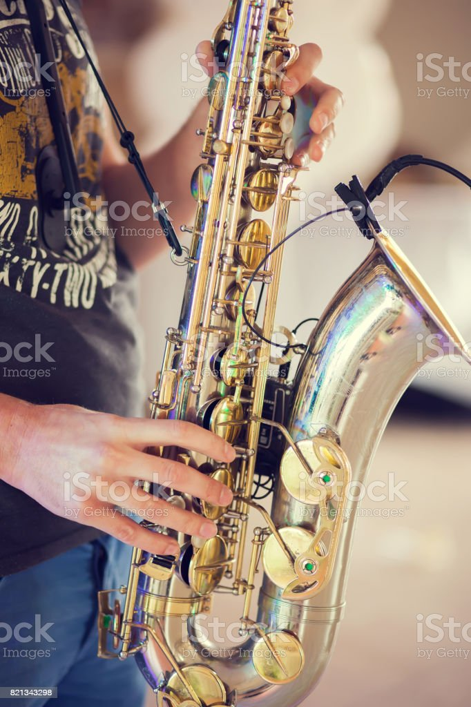 A man with saxophone in hands stock photo