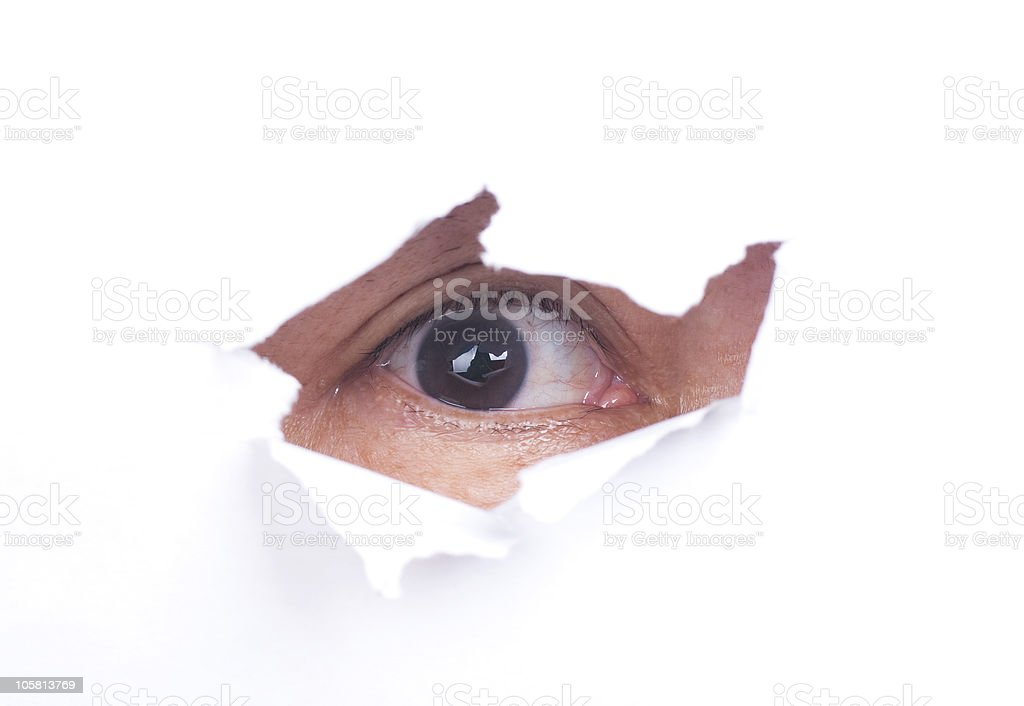 Man with scary look from paper hole royalty-free stock photo