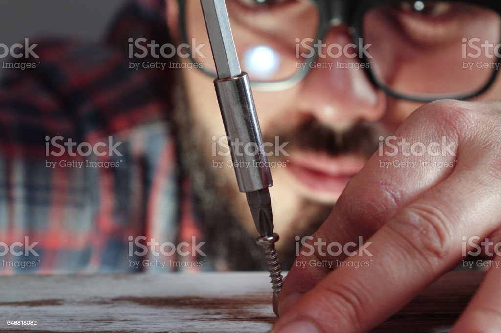 Man with screwdriver stock photo