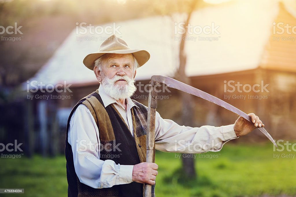 Man with scythe stock photo