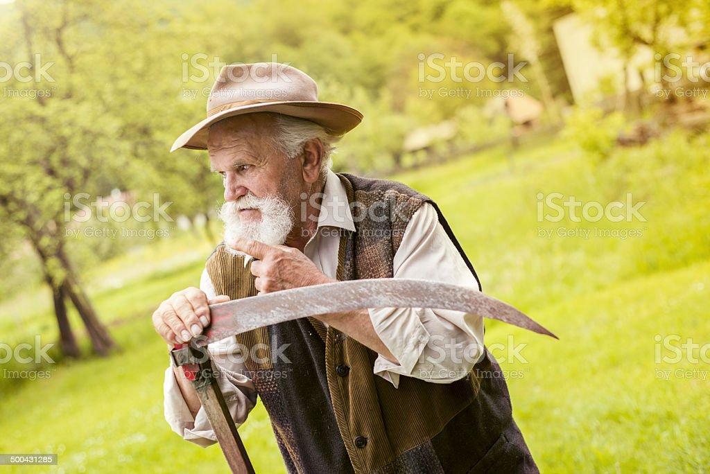 Man with scythe stock photo