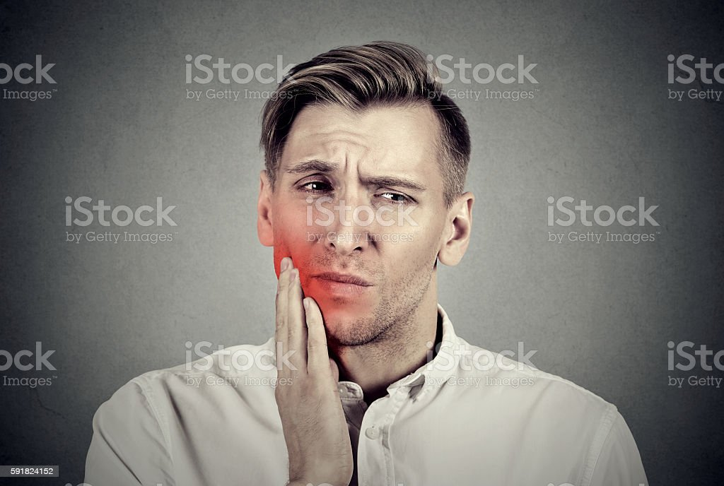 Man with sensitive toothache problem pain stock photo