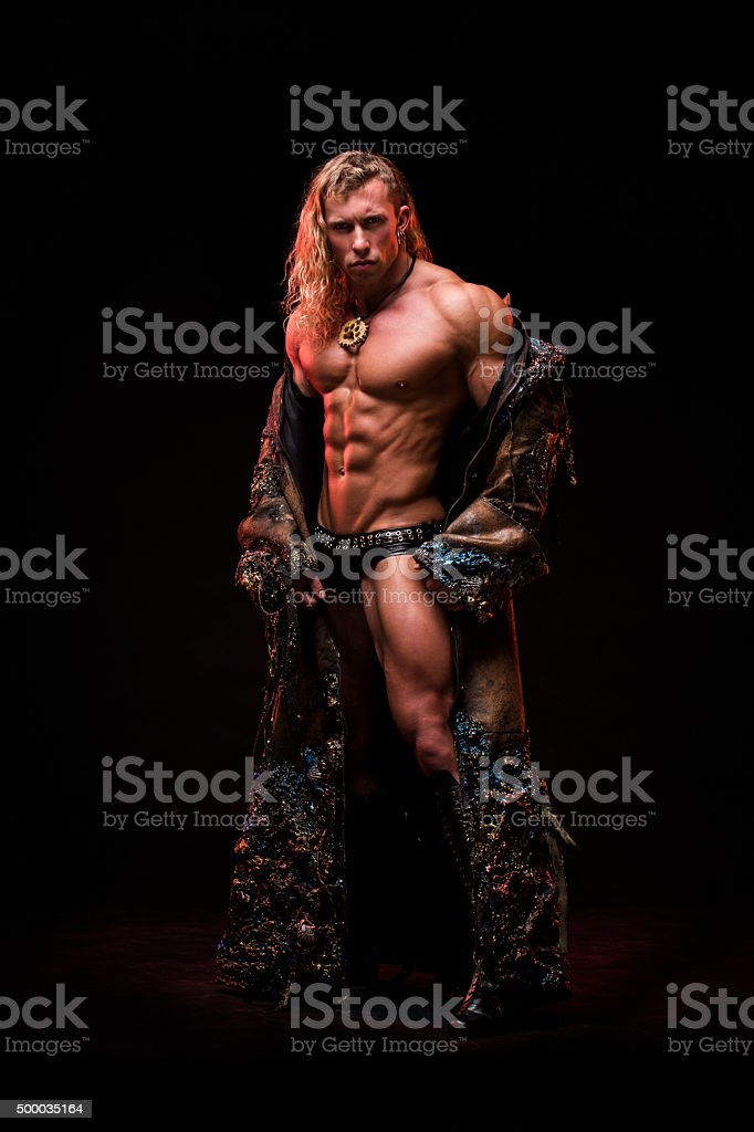 Man with sexy strong muscular body dressed in costume monster stock photo