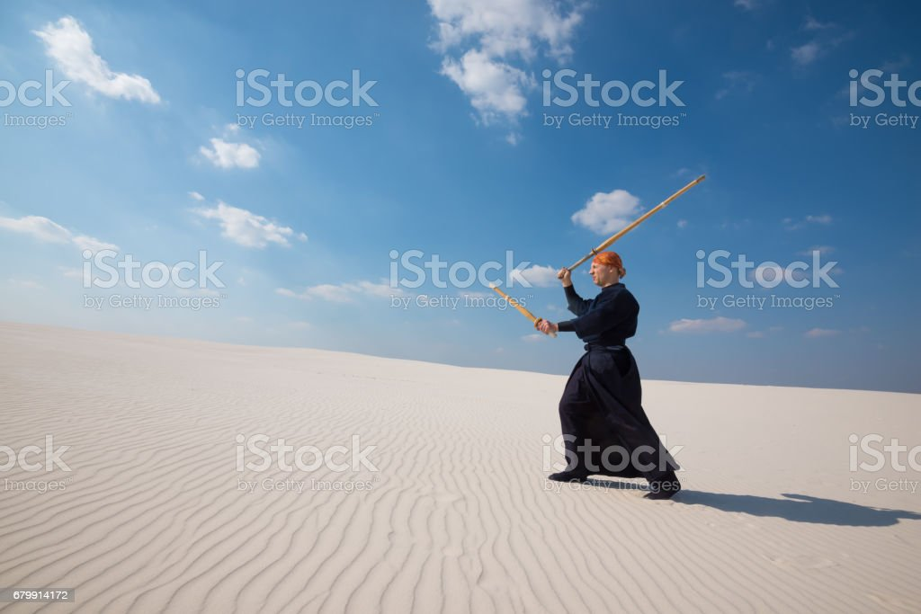 Man with shinai in traditional Japanese clothes. Wide angle stock photo
