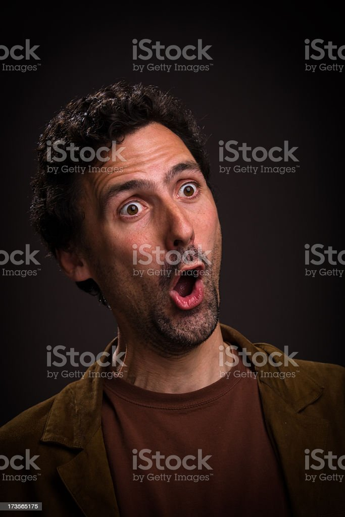 Man with shocked expression on his face stock photo