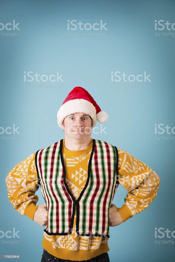 Man With Shocked Look Wearing Santa Hat and Ugly Sweater royalty-free stock photo