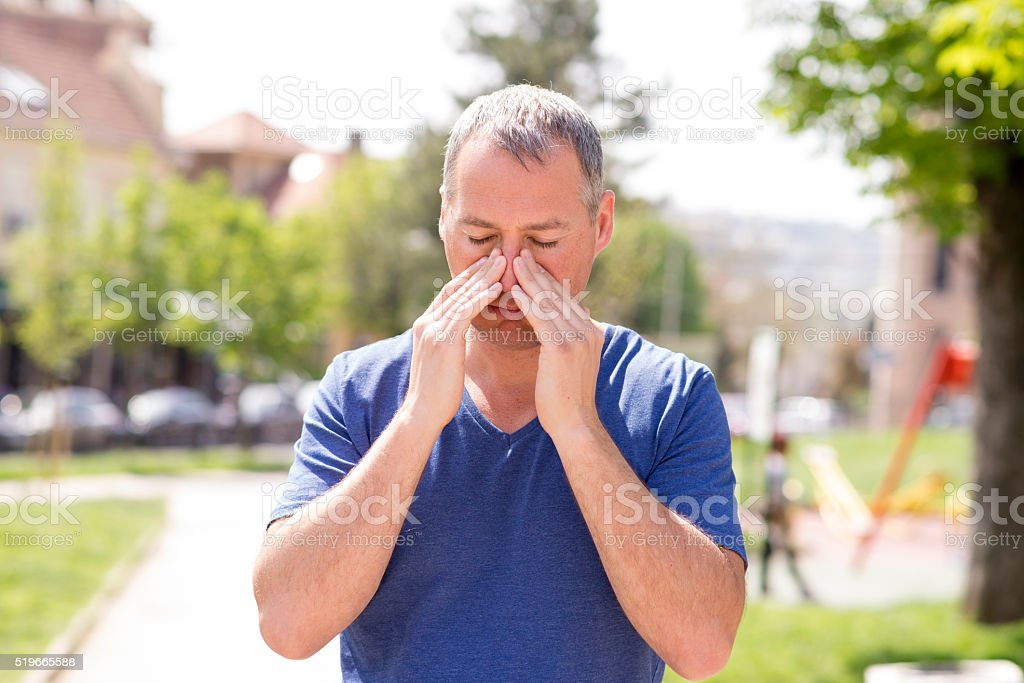Man with sinus pain stock photo