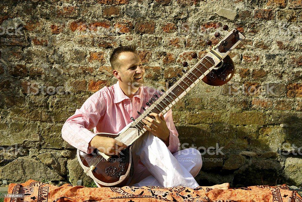 man with sitar stock photo