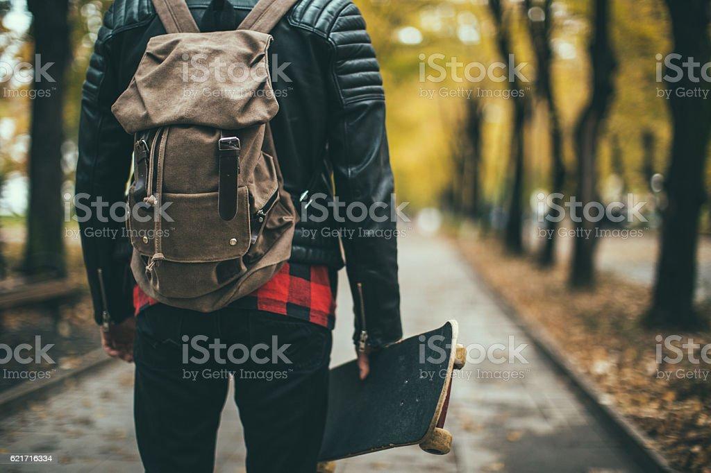 Man with skateboard stock photo