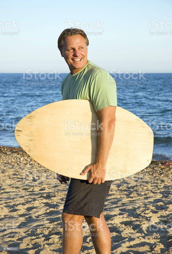 man with skimboard stock photo
