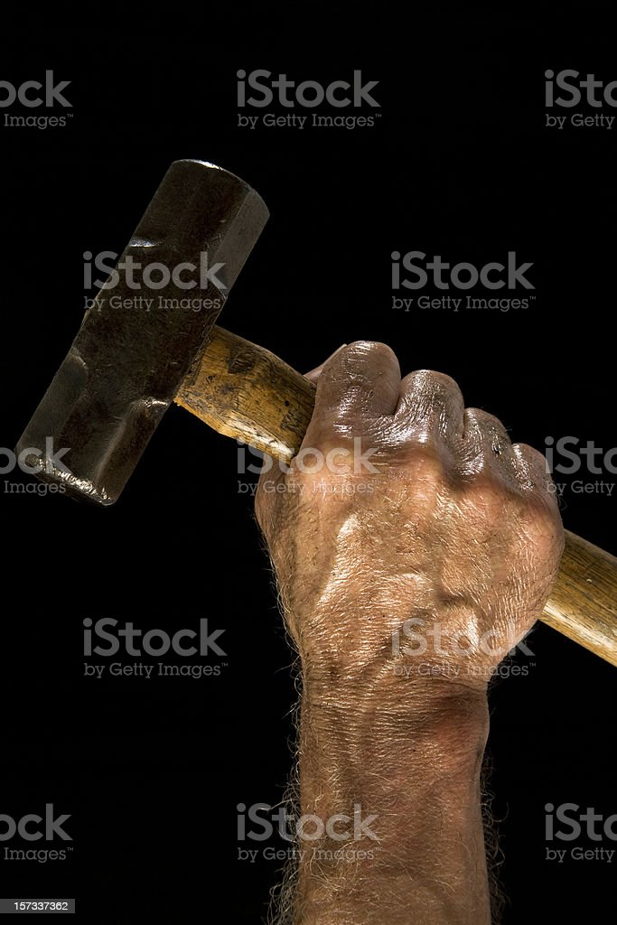 Man with sledgehammer. Dirty, greasy. Working class. Hand. stock photo