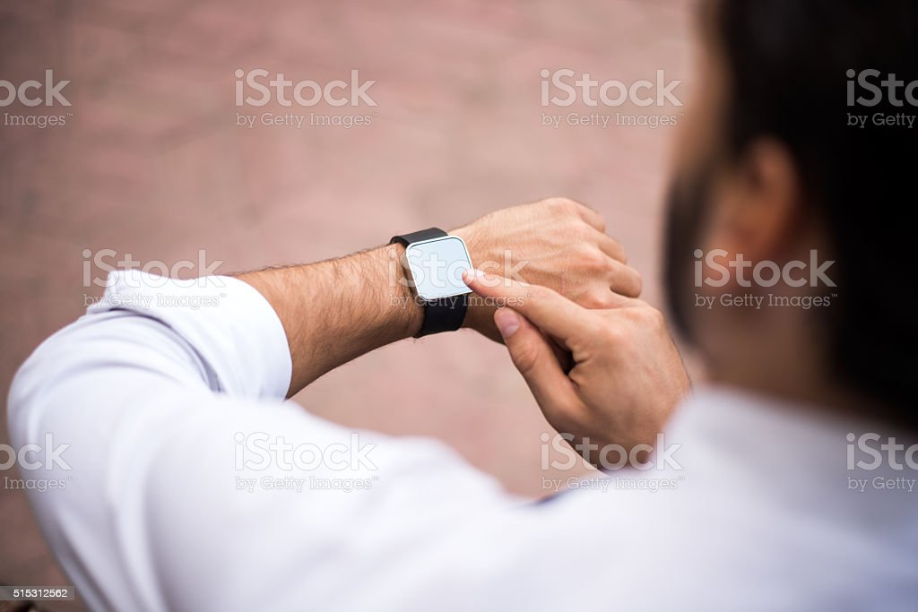 Man with smart watch stock photo