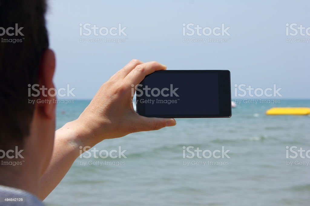 man with smartphone on beach royalty-free stock photo