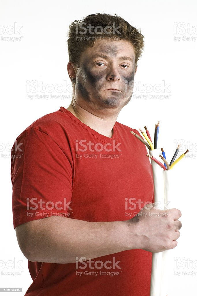 Man with smoked black face holds two cable. royalty-free stock photo