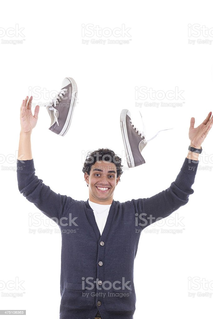 man with sneakers throwing them away stock photo