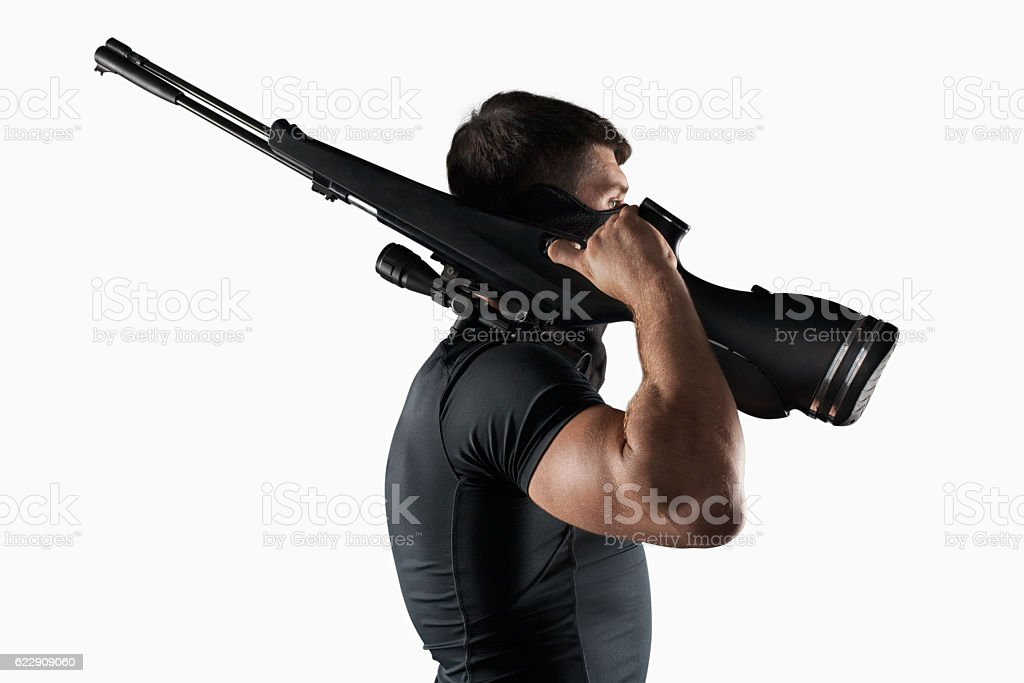 Man with sniper rifle side view isolated stock photo