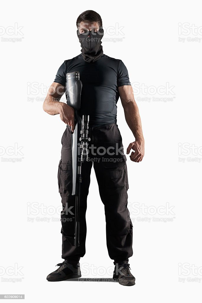 Man with sniper rifle standing isolated stock photo