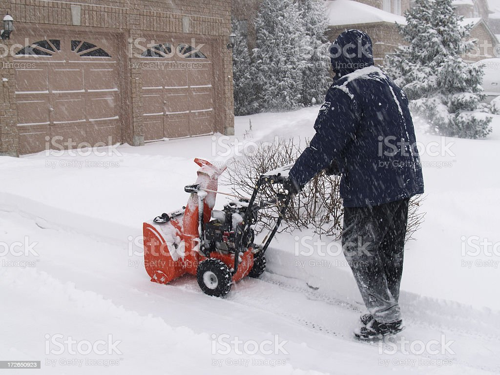 Man with snowblower royalty-free stock photo