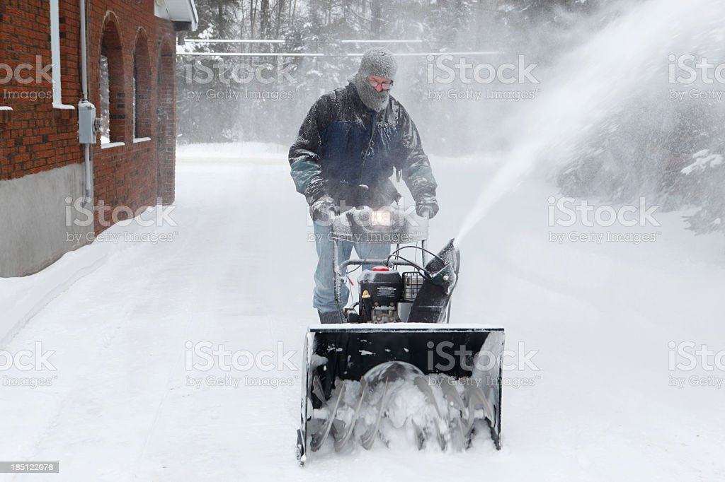 Man with snowblower stock photo