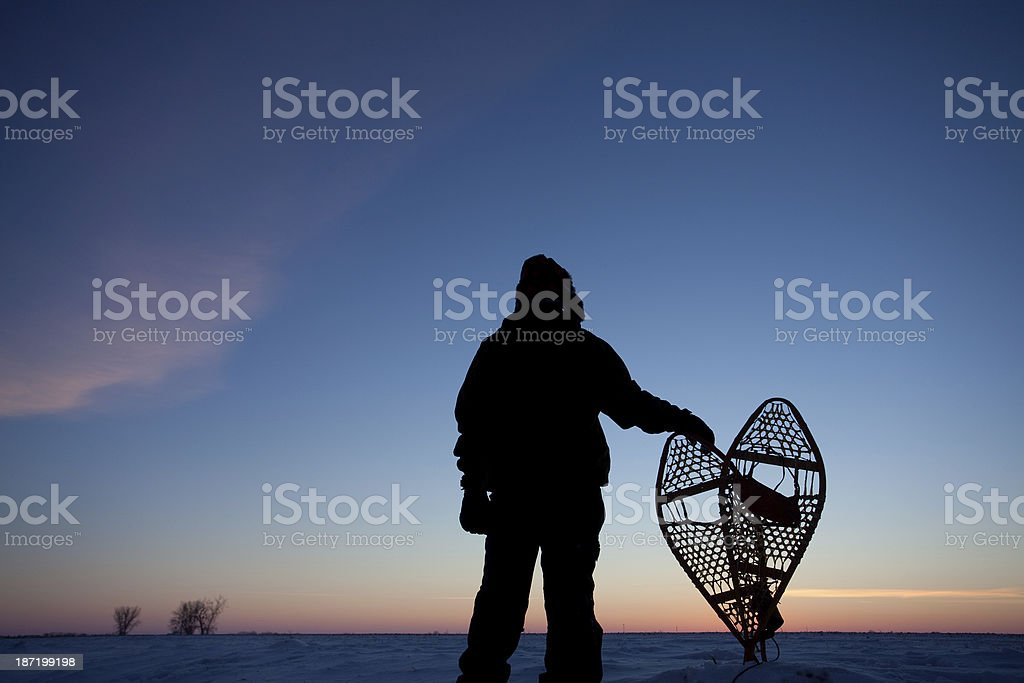 Man With Snowshoes in Northern Canada stock photo