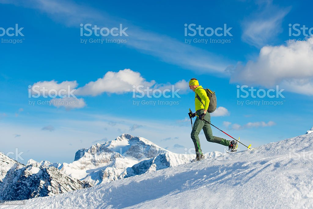 Man with snowshoes stock photo
