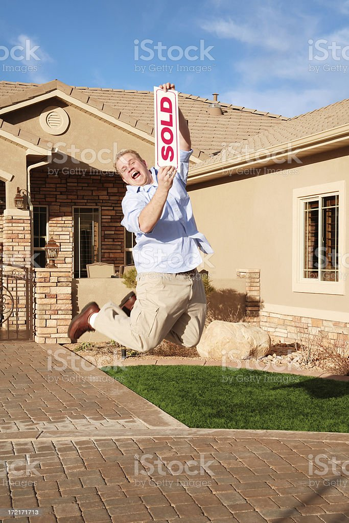 Man with Sold Home Jumping for Joy royalty-free stock photo
