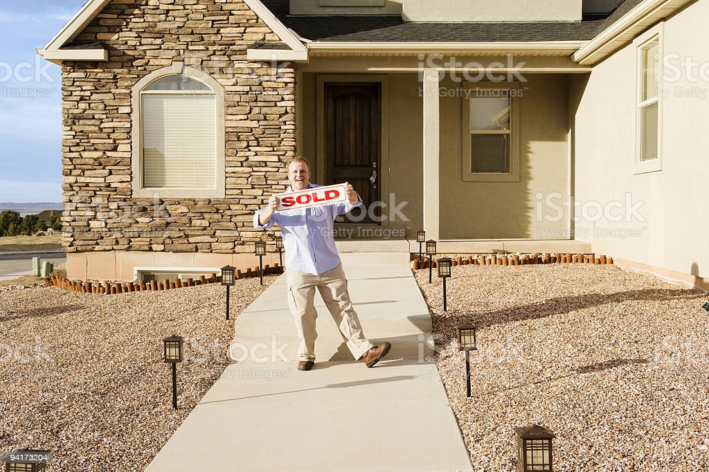 Man with Sold Home stock photo