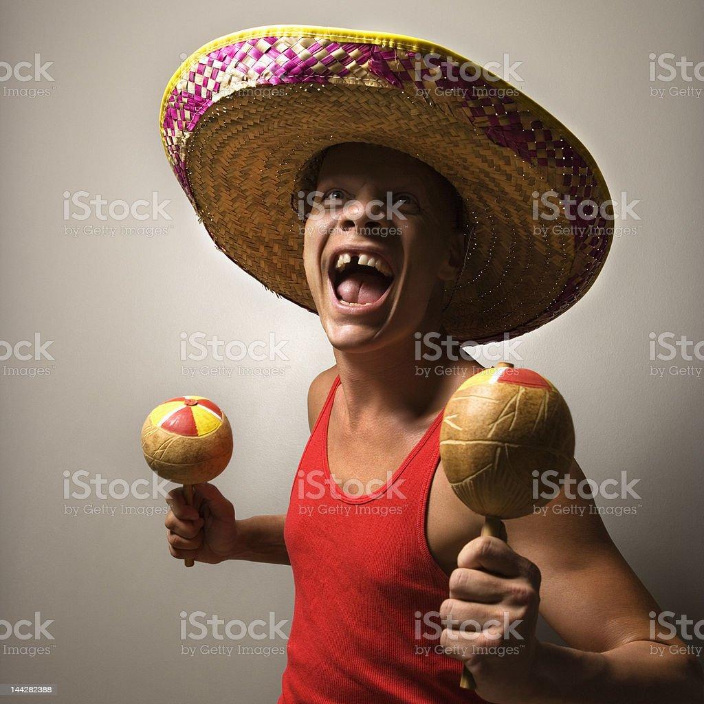 Man with sombrero and maracas. stock photo