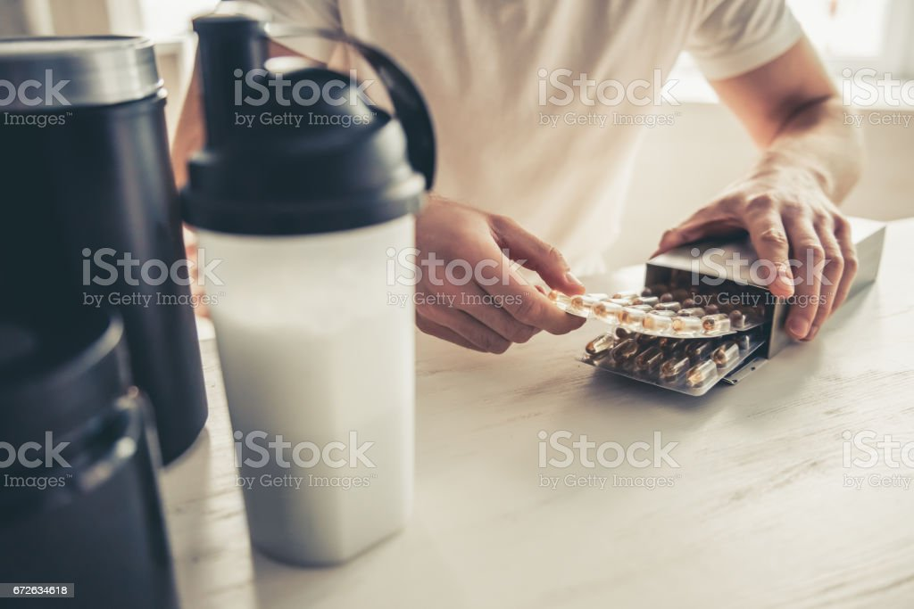 Man with sport nutrition stock photo