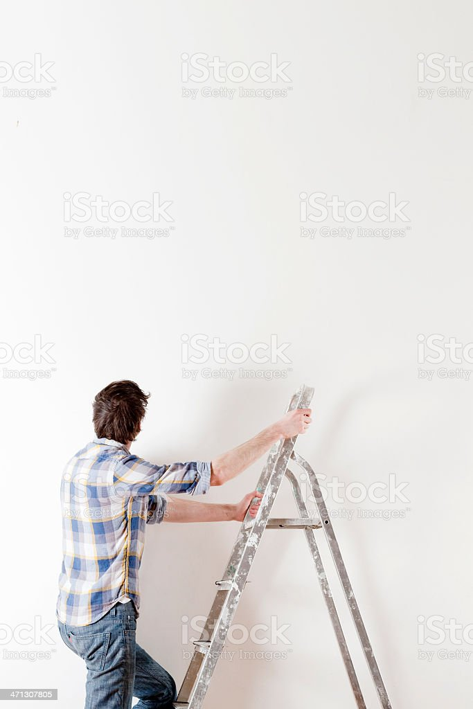 Man with step ladder royalty-free stock photo