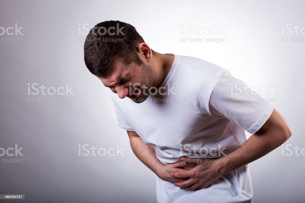 Man with stomachache stock photo