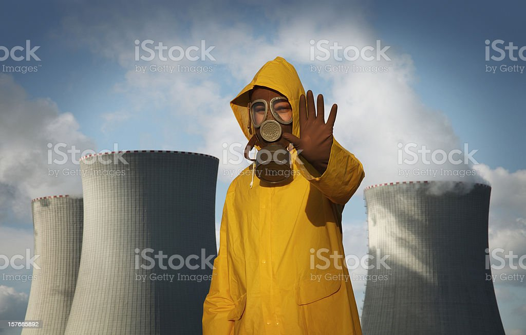 Man With 'Stop' Gesture in Front of Nuclear Reactor stock photo