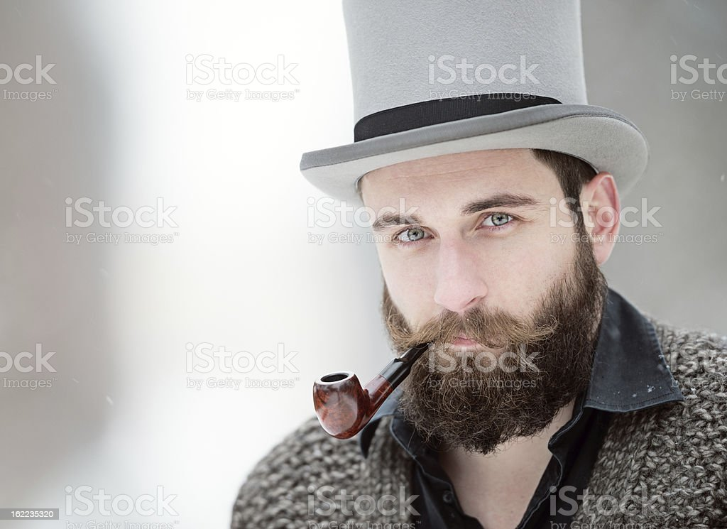 Man with Stovepipe Tophat and Pipe stock photo