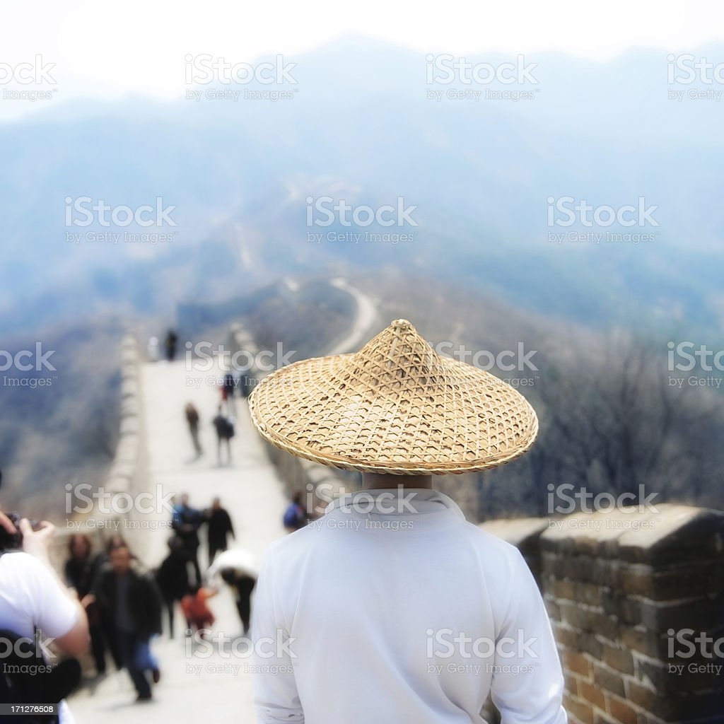 Man with straw hat on Chinese Wall stock photo