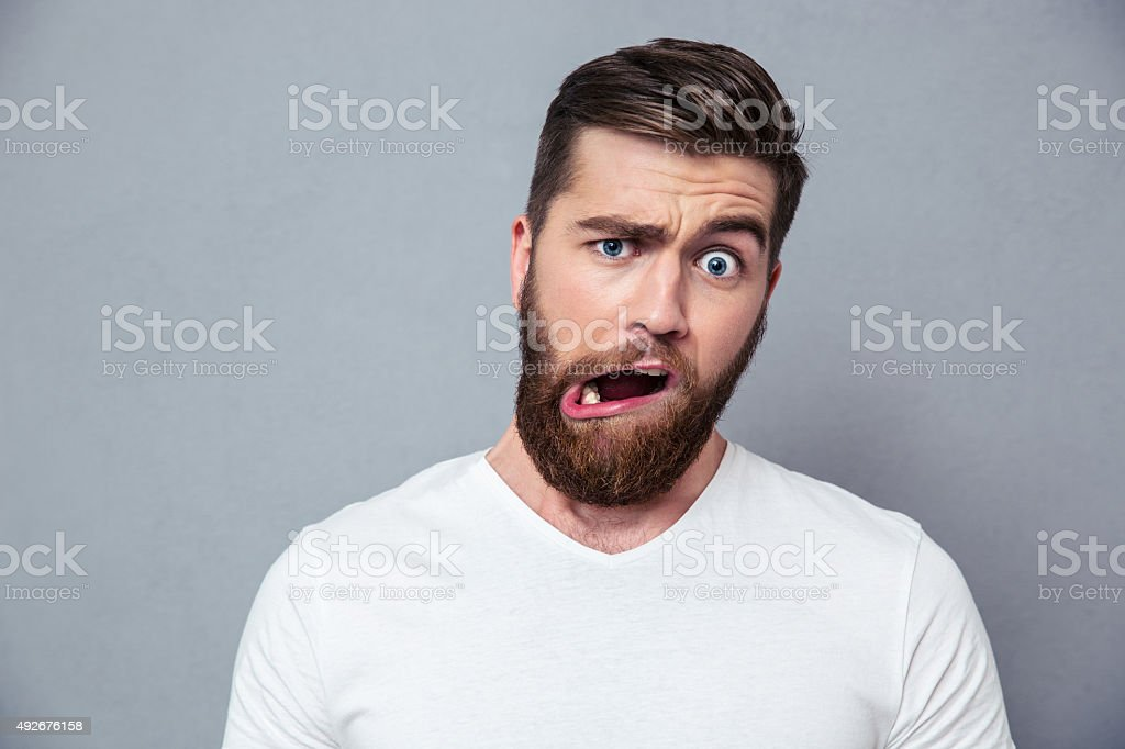 Man with stupid mug stock photo