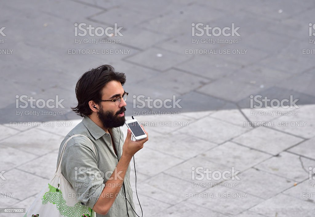 Man with style. Using mobile smart phone stock photo