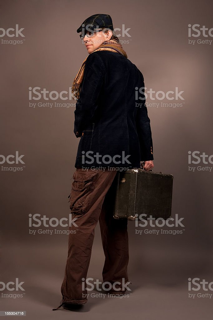 man with suitcase looking backwards royalty-free stock photo