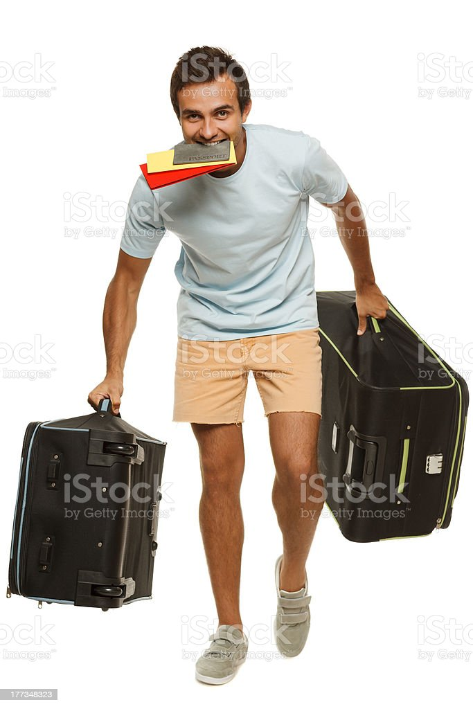 Man with suitcases hurrying royalty-free stock photo