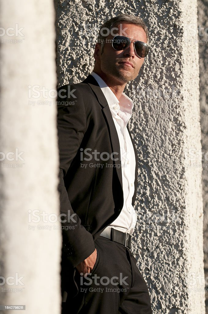 man with sunglasses looking up royalty-free stock photo