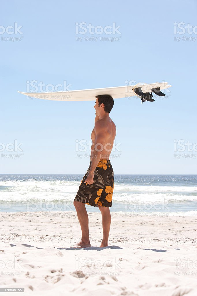 Man with surfboard on beach royalty-free stock photo